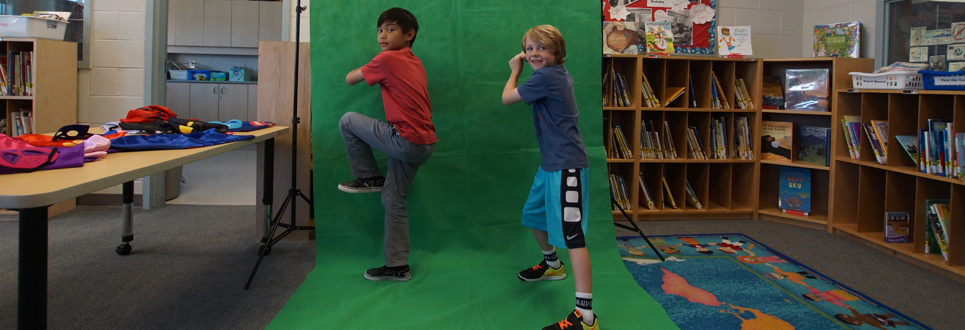 Two male students posing on the Green Screen