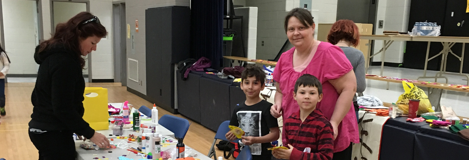 St. John Bosco Catholic School parent volunteer with two students.